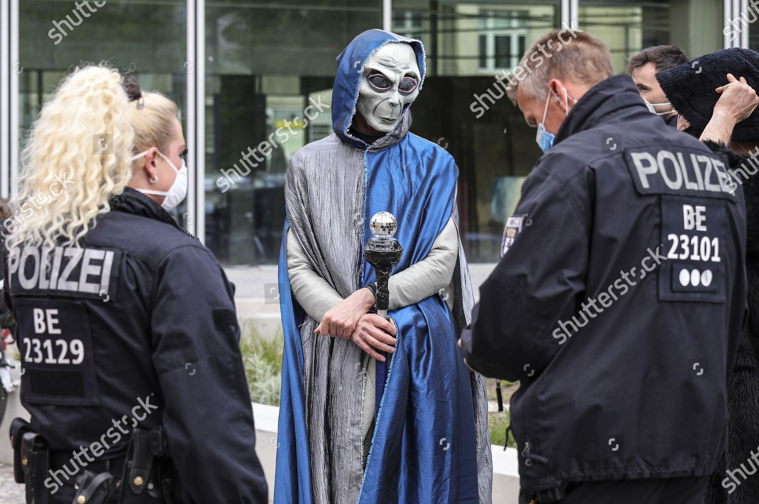 Halloween In Germany 2020 German police officers question performer alien costume Editorial