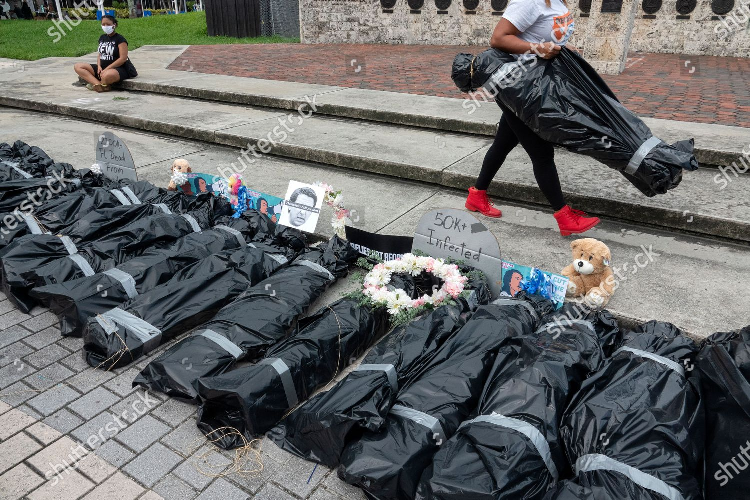 Foto de stock de Symbolic funeral procession to protest against the economy reopening without Coronavirus relief in Miami, USA - 27 May 2020