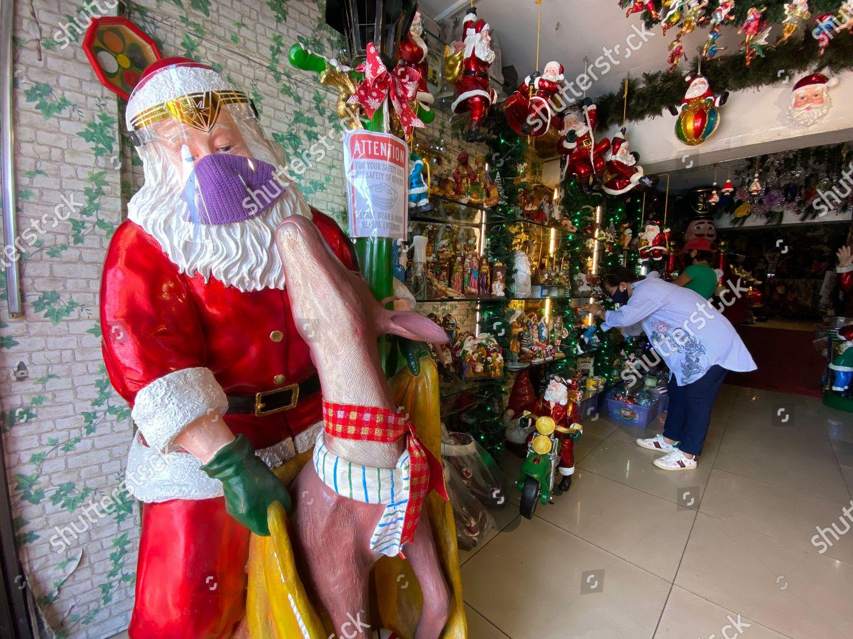 Manila Christmas Events 2020 Santa Claus figure face mask face shield Editorial Stock Photo