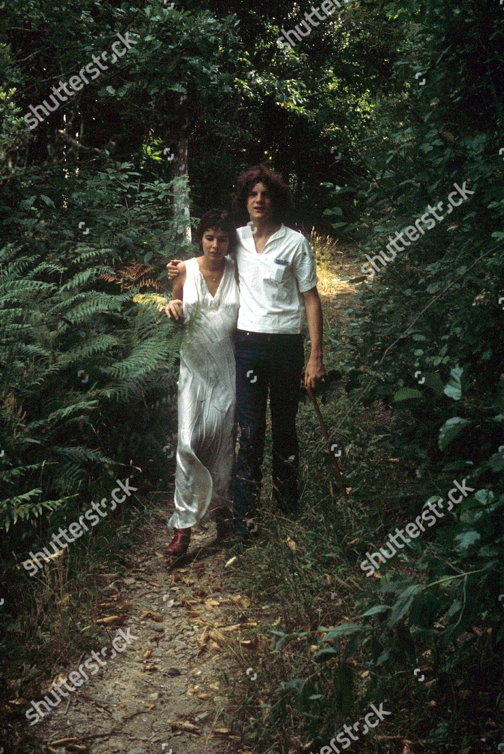 Stock photo of PAUL GETTY III JNR AND WIFE MARTINE WALKING IN THE COUNTRY - 1984