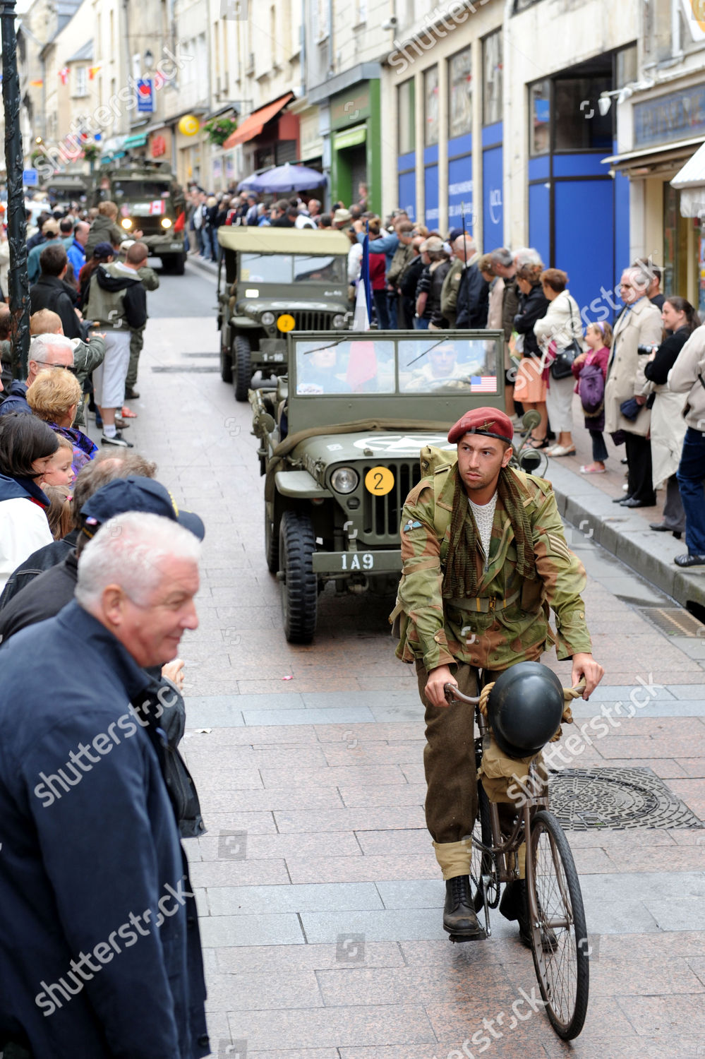 Re Enactors Have A Parade Through The Streets Of Bayeux With Their Historical World War