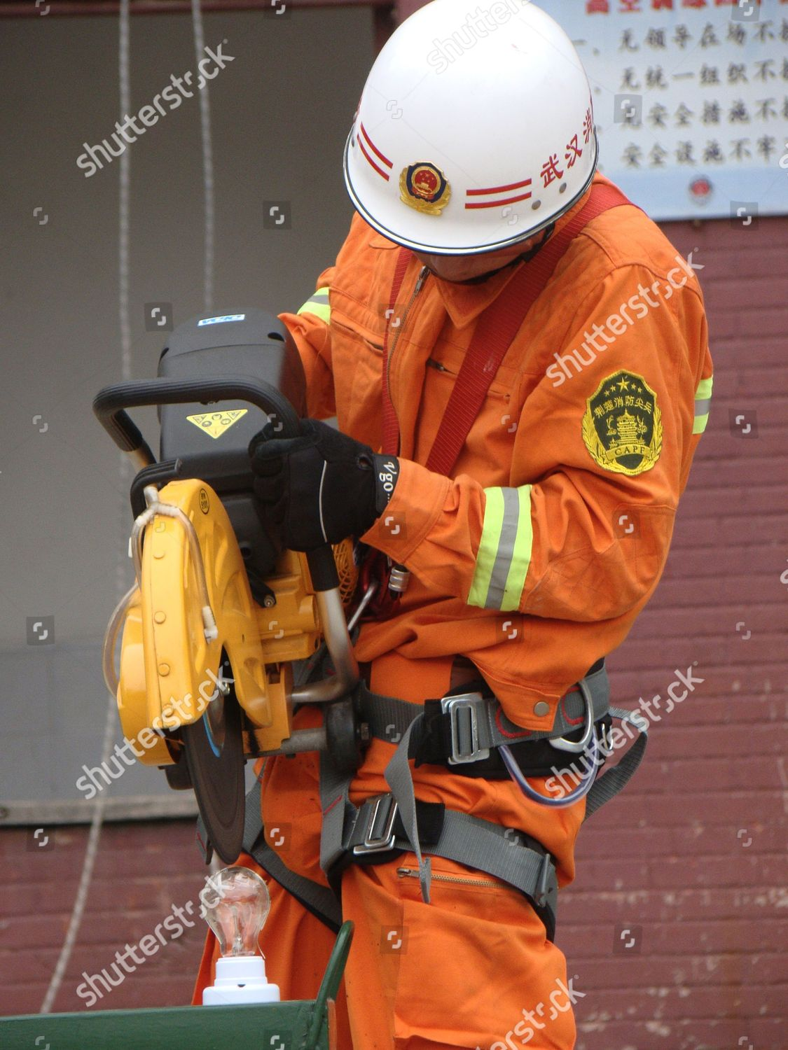 firefighters uses electric saw cut through piece Editorial Stock