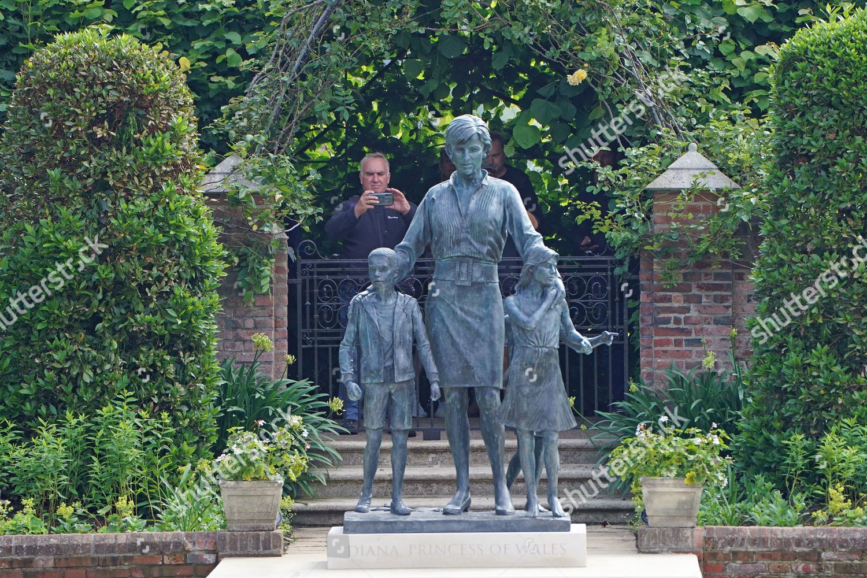 Stock photo of Members of the public view Princess Diana statue, Kensington Palace, London, UK - 02 Jul 2021