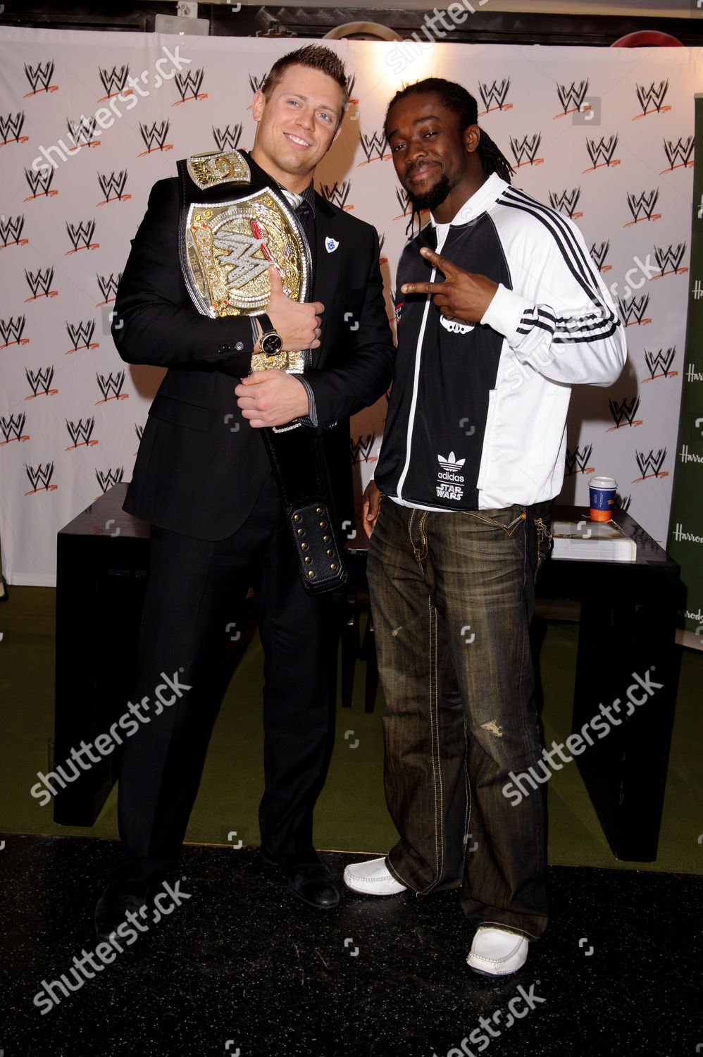 Stock photo of WWE stars The Miz and Kofi Kingston launching a collection of figurines and branded merchandise, Harrods, London, Britain - 19 Apr 2011