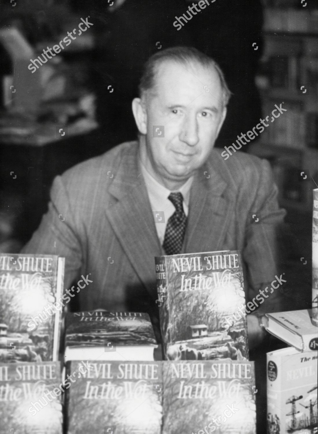 Author Nevil Shute Autographing His Novels Bourne Editorial Stock
