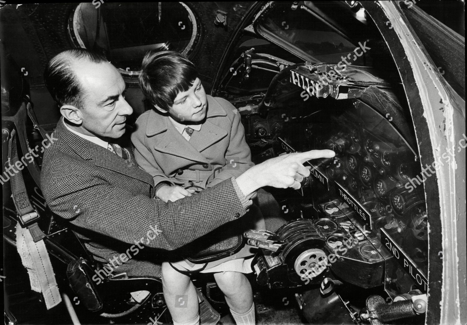 d2cd7e9d ... Squadron Leader Henry Tempest Showing His Daughter Sally (9) The  Cockpit Of Vulcan Bomber On The Raf Stand Stock Image by Derek Cattani for  editorial ...