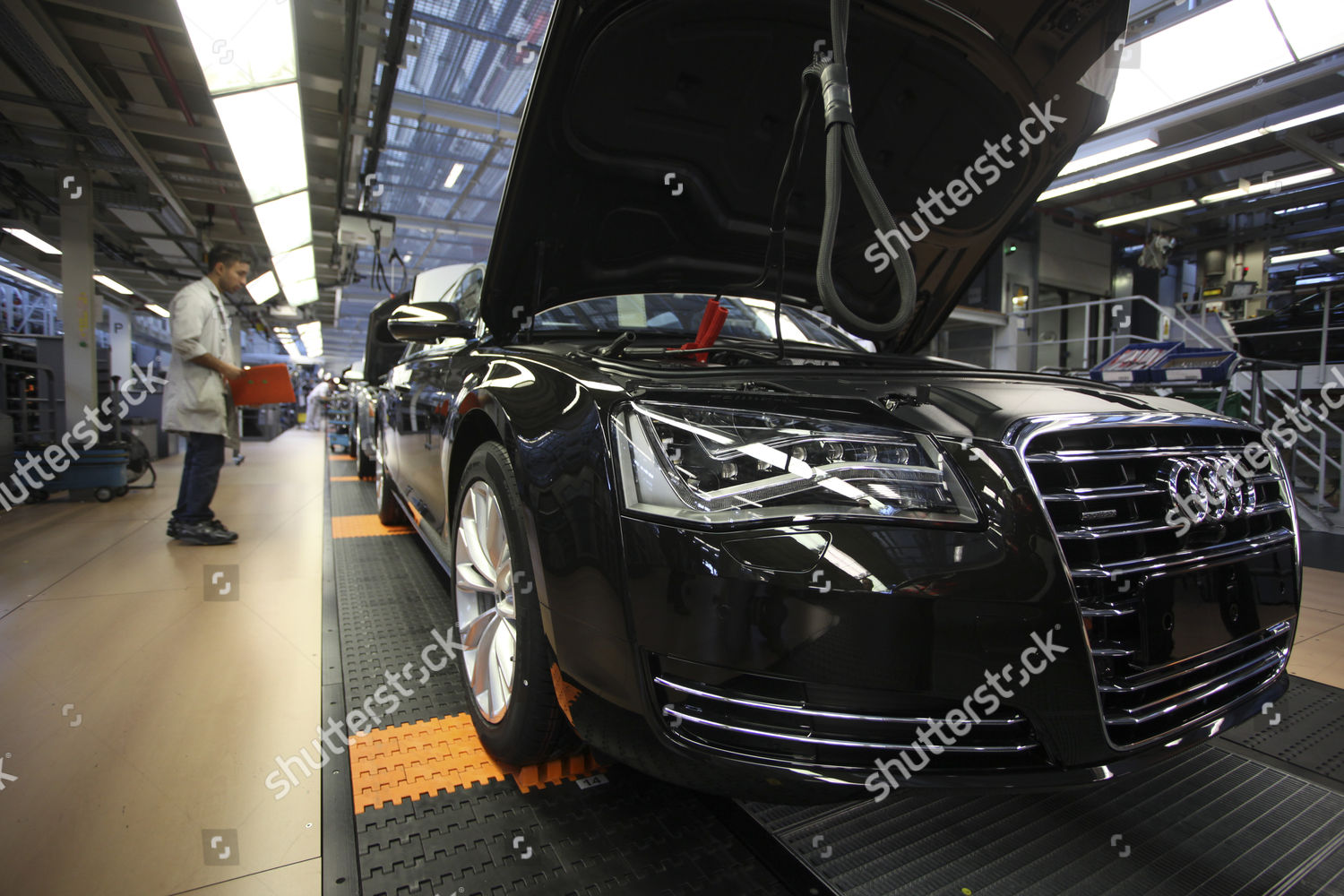 Employees fits parts Audi motorcar on production Editorial