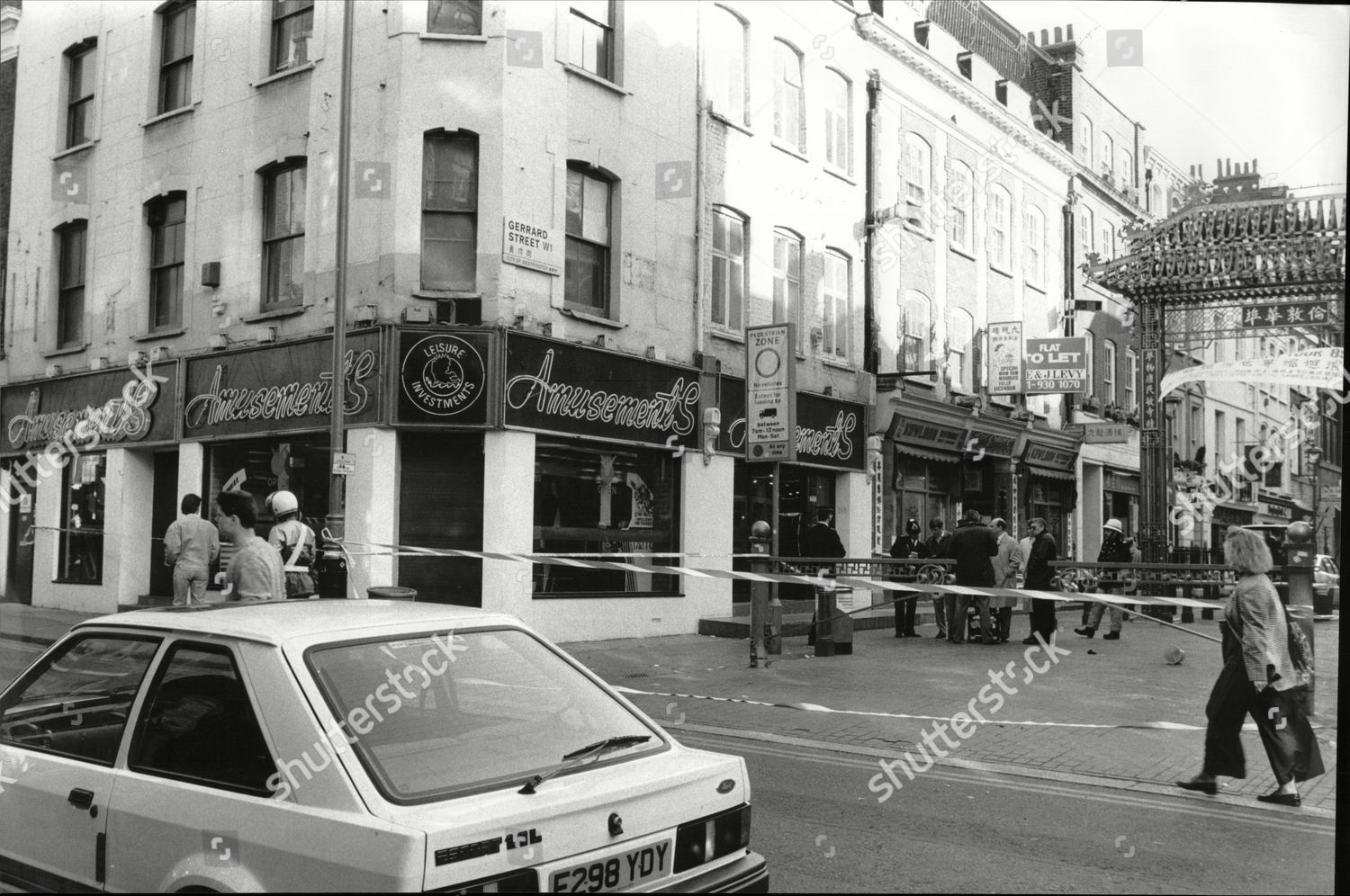 Stock photo of Law Crime Murder 1989 Police Cordon Off The Amusement Arcade In Gerrard Street London After Two Men Died When They Were Doused With Paraffin And Set Alight In The Arcade