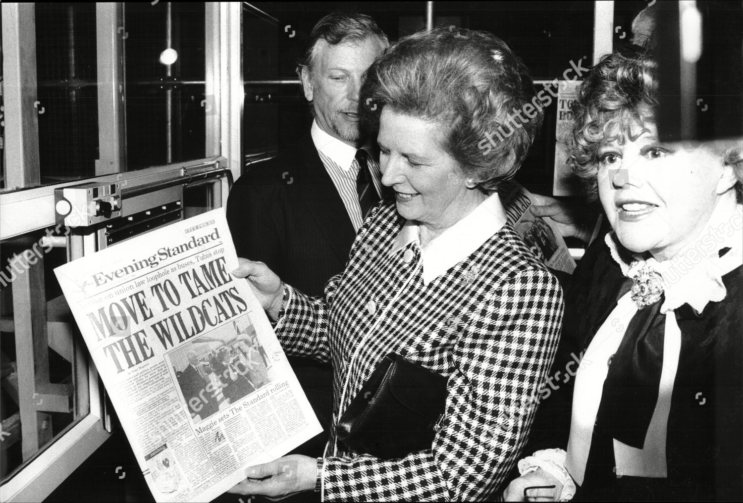Stock photo of Margaret Thatcher Prime Minister Tours Evening Standard's Printing Presses At Harmsworth Quays; Here Holding Front Page Bearing A Photo Of Her Arrival Half An Hour Earlier With Patricia Harmsworth / Viscountess Rothermere 1989.