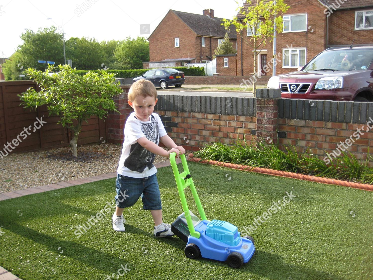 Astro Turf Garden >> Steve Woolnoughs Grandson Mowing Astro Turf Before Editorial