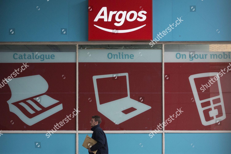 People walking past Argos store London Argos Editorial Stock
