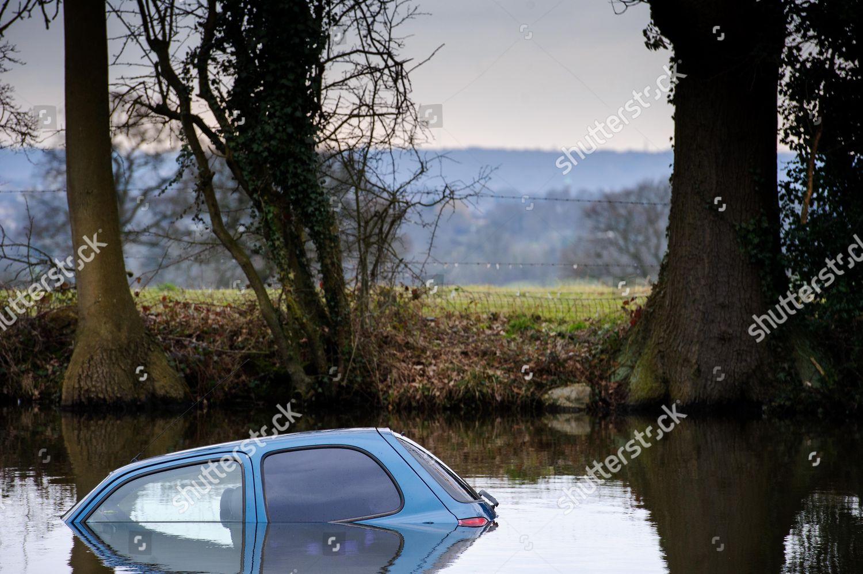 car submerged lake stock photo (2161676f) - shutterstock editorial photo