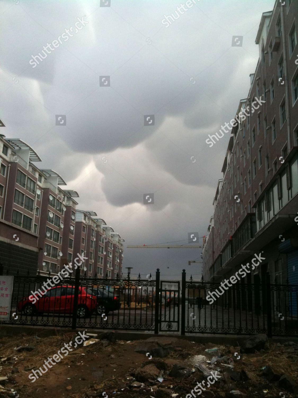 Mammary mammatus clouds above city Editorial Stock Photo