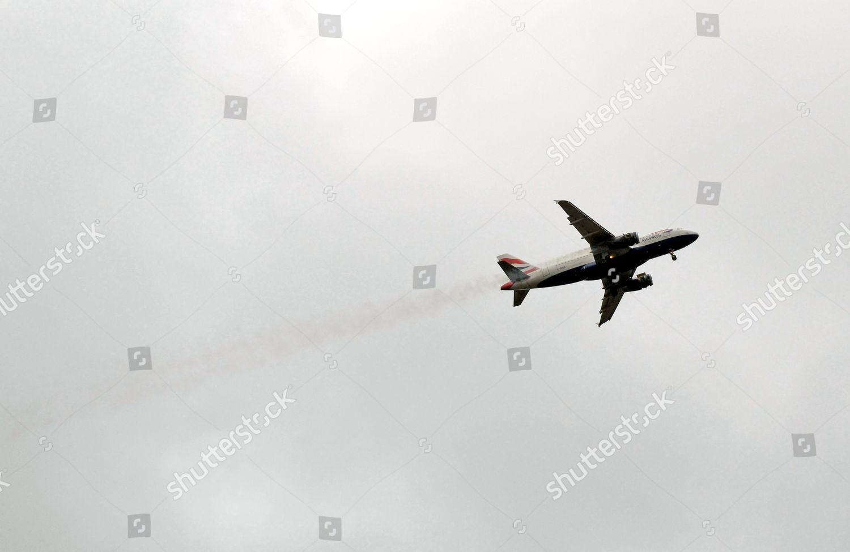 BA762 plane above Heathrow smoke billowing engine Editorial