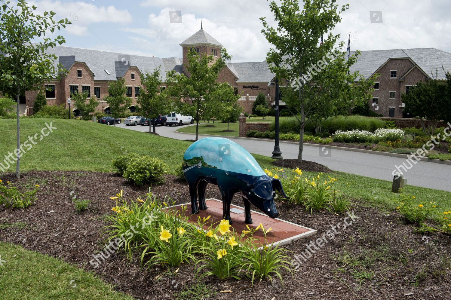 Decorated pig statues out front Smithfield Foods Editorial