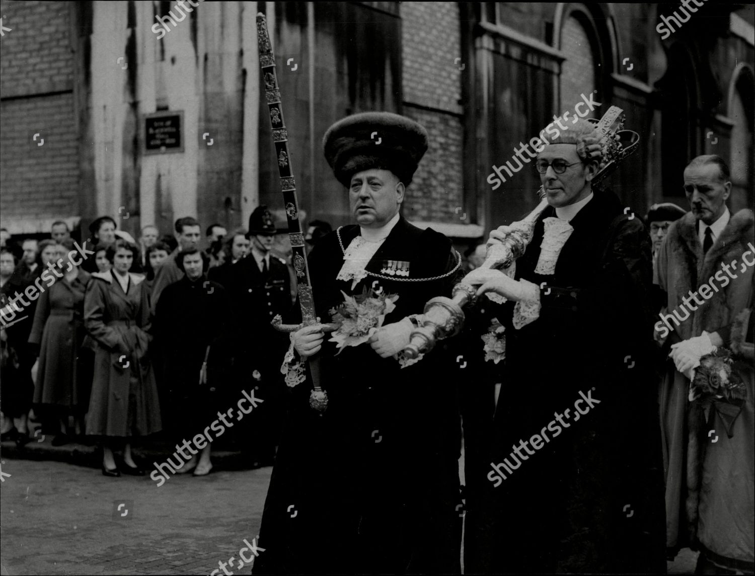 Stock photo of The City Sword Bearer William Thomas Boston And The Common Cryer Sergeant At Arms Commander J.r.poland Carrying The Mace.