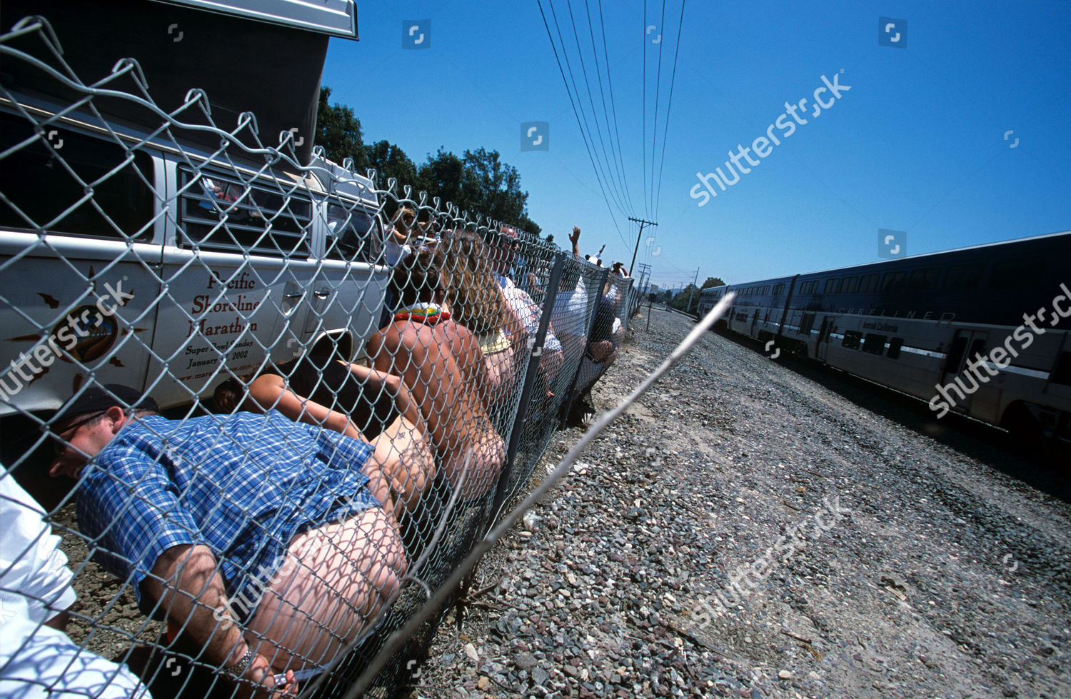 Amtrak Mooning Pictures people against fence mooning amtrak train editorial stock