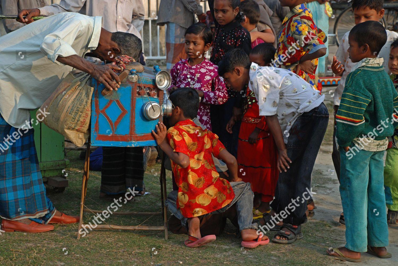 Rural children watching Still Movie bioscope Eid Editorial