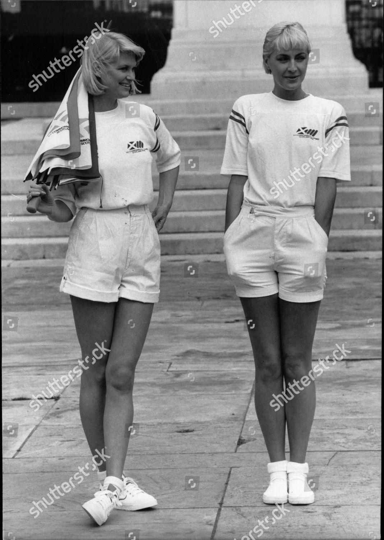 Stock photo of Commonwealth Games Edinburgh 1986. Model Girls Karen Preston And Carole Royd Wearing The Games T-shirts And Shorts.