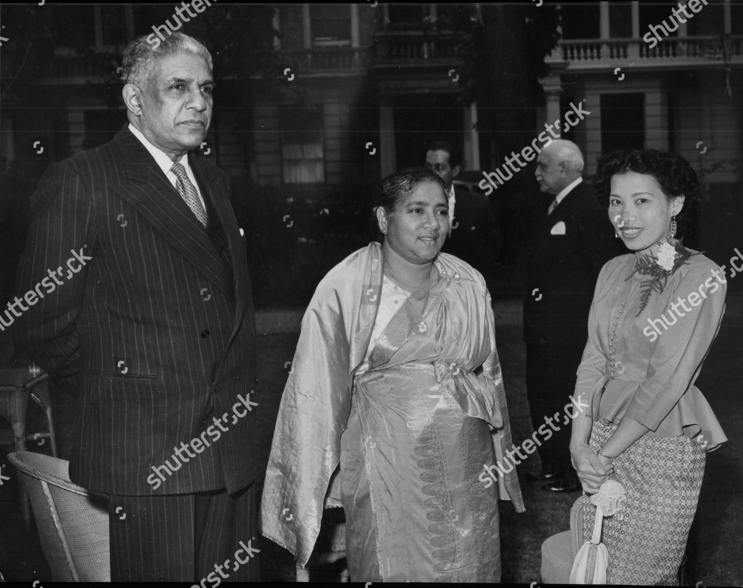 Stock photo of Sir Edwin Wijeyeratne Ceylon High Commissioner In London With His Wife (centre) And Mrs Wilairat At A Reception.