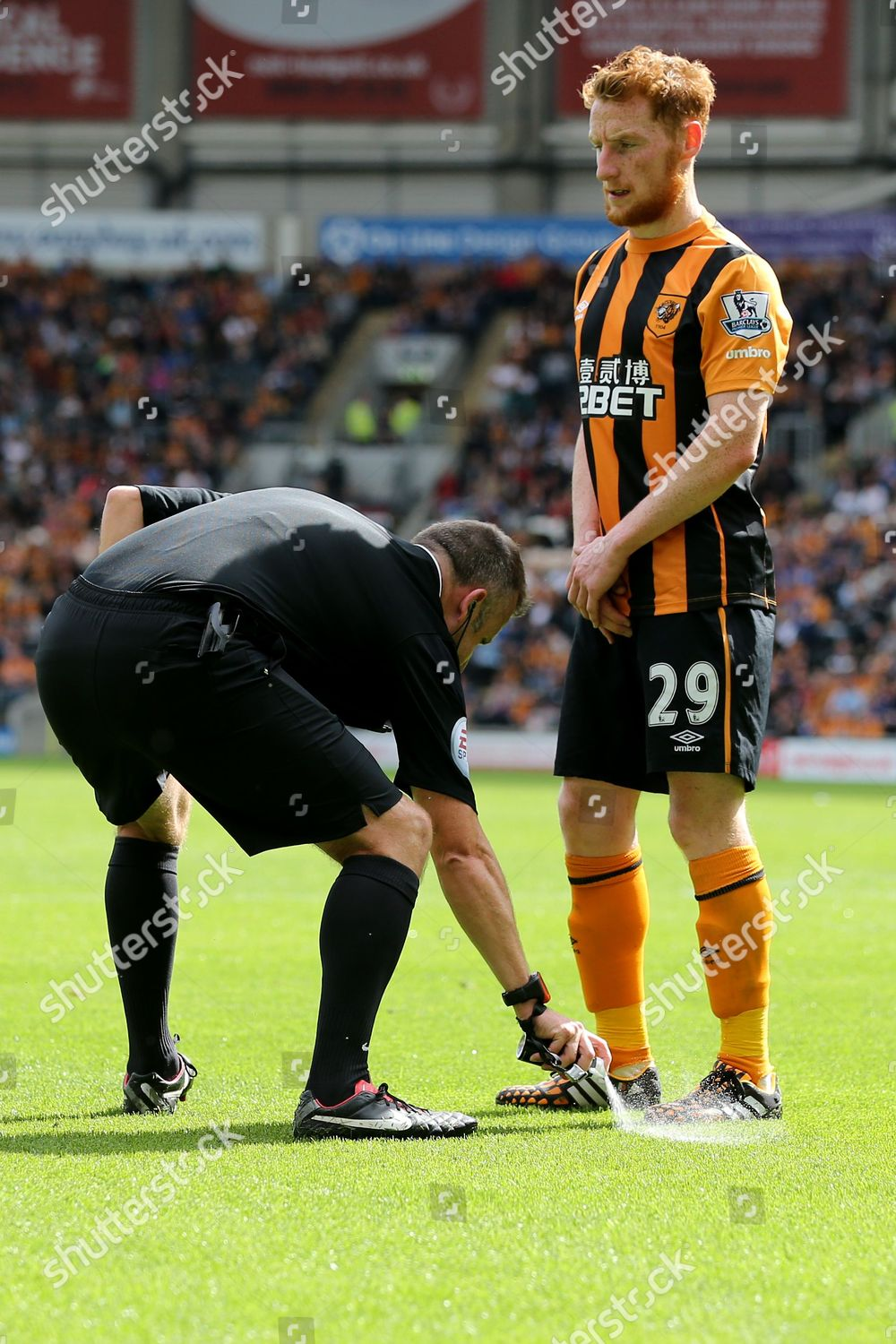 Referee Mr Jonathan Moss sprays vanishing spray Editorial Stock