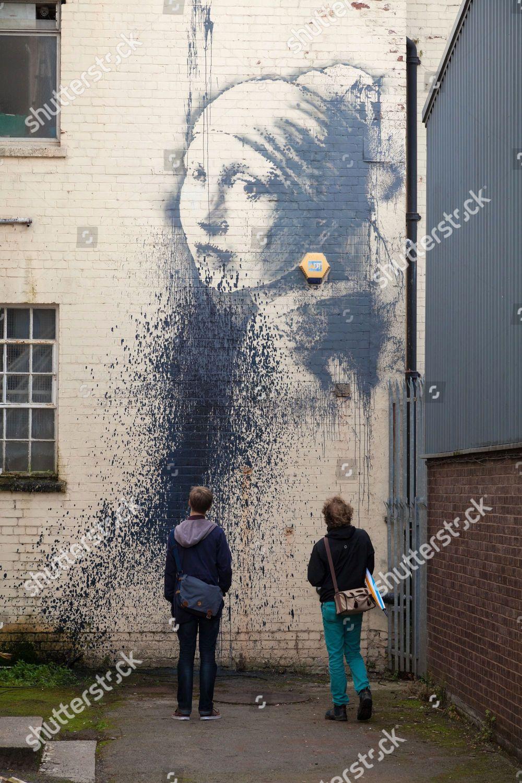 Defaced Girl Pierced Eardrum graffiti artwork Editorial