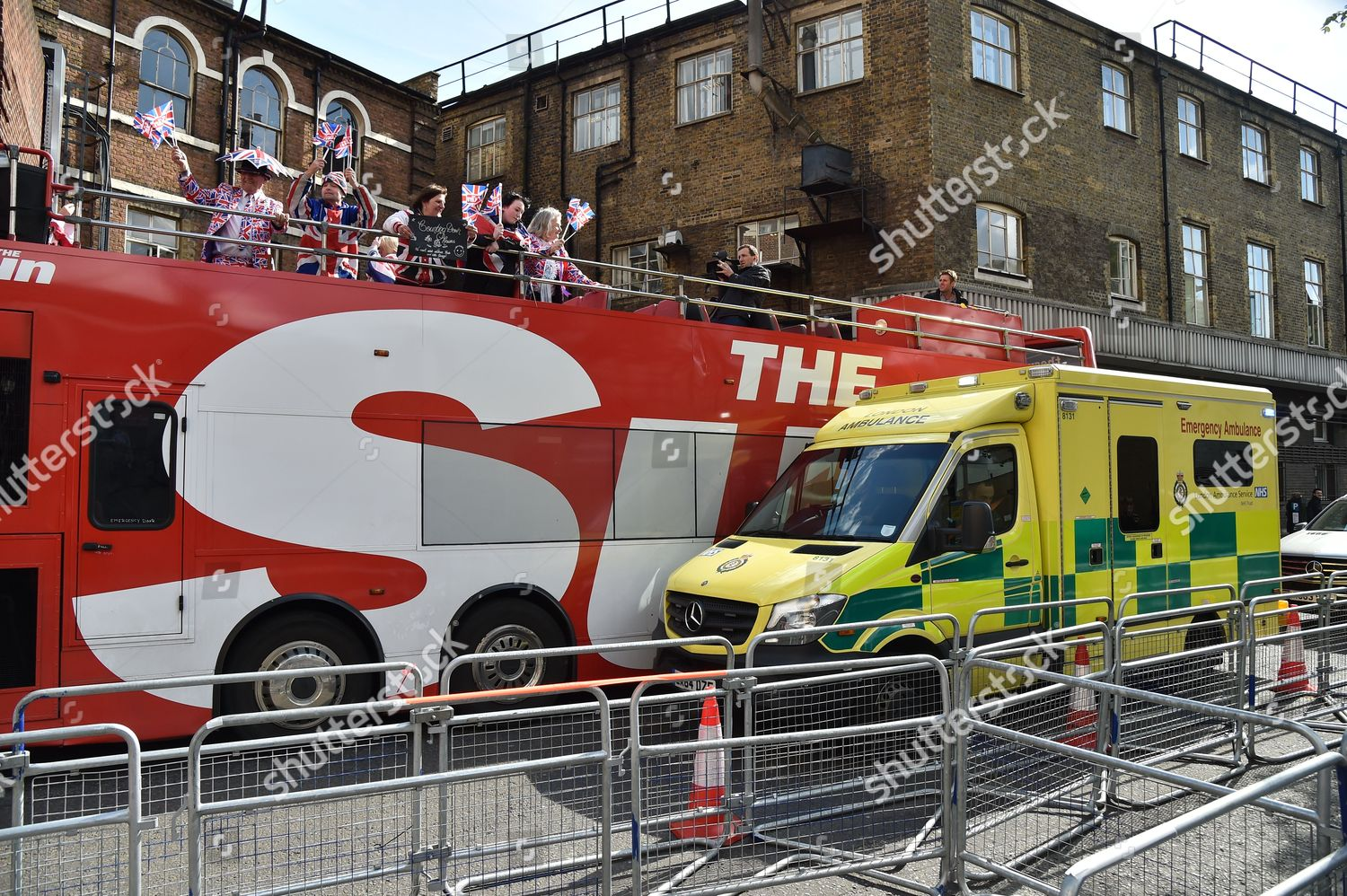 Sun bus blocks route ambulance outside Accident Editorial Stock