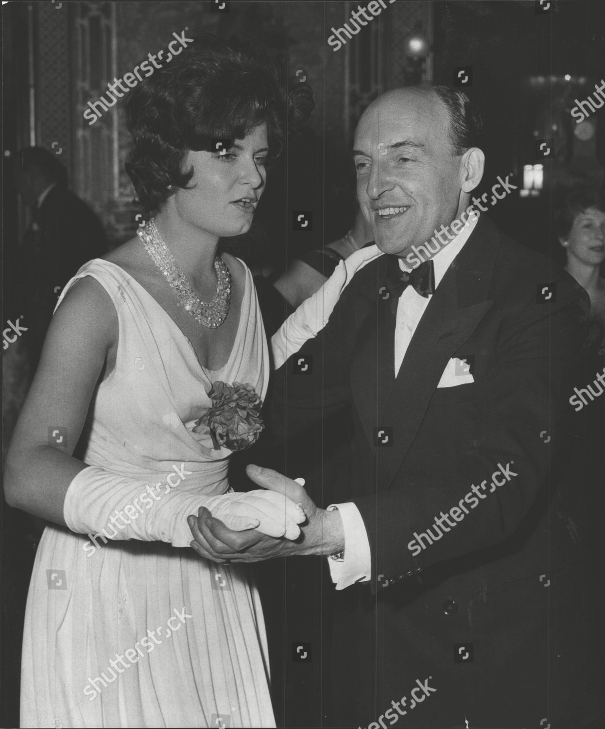 Stock photo of Mr Brian Maccabe Former Olympic Athlete Now Chairman Of Foote Cone And Belding Dancing With Mrs Judy Auld At The Civic Ball At The Brighton Pavilion. Box 0557 040315 00095a.jpg.