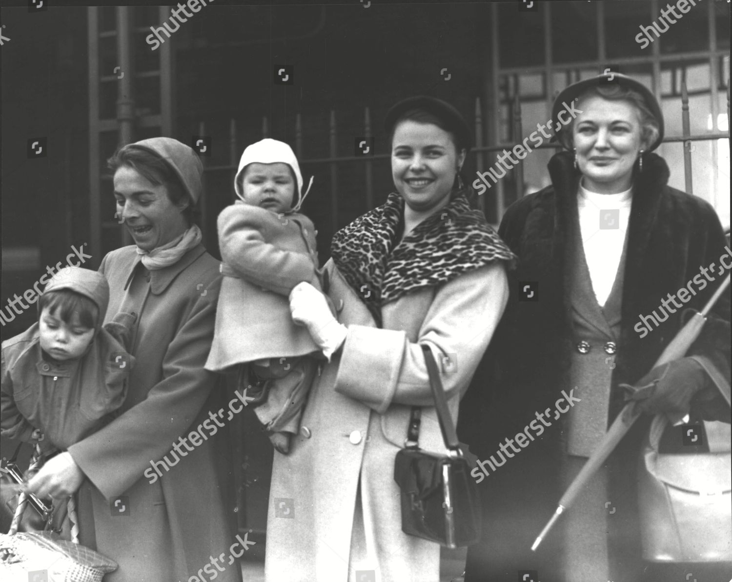 Stock photo of Members Of The Australian Embassy Staff In Moscow Arriving In Tilbury After They Were Expelled When Russia Broke Off Diplomatic Relations Over The Petrov Affair. L-r: Mrs Brian Hill And Son Edwin Mrs Richard Woolcott And Son Peter And Mrs Patricia Ro