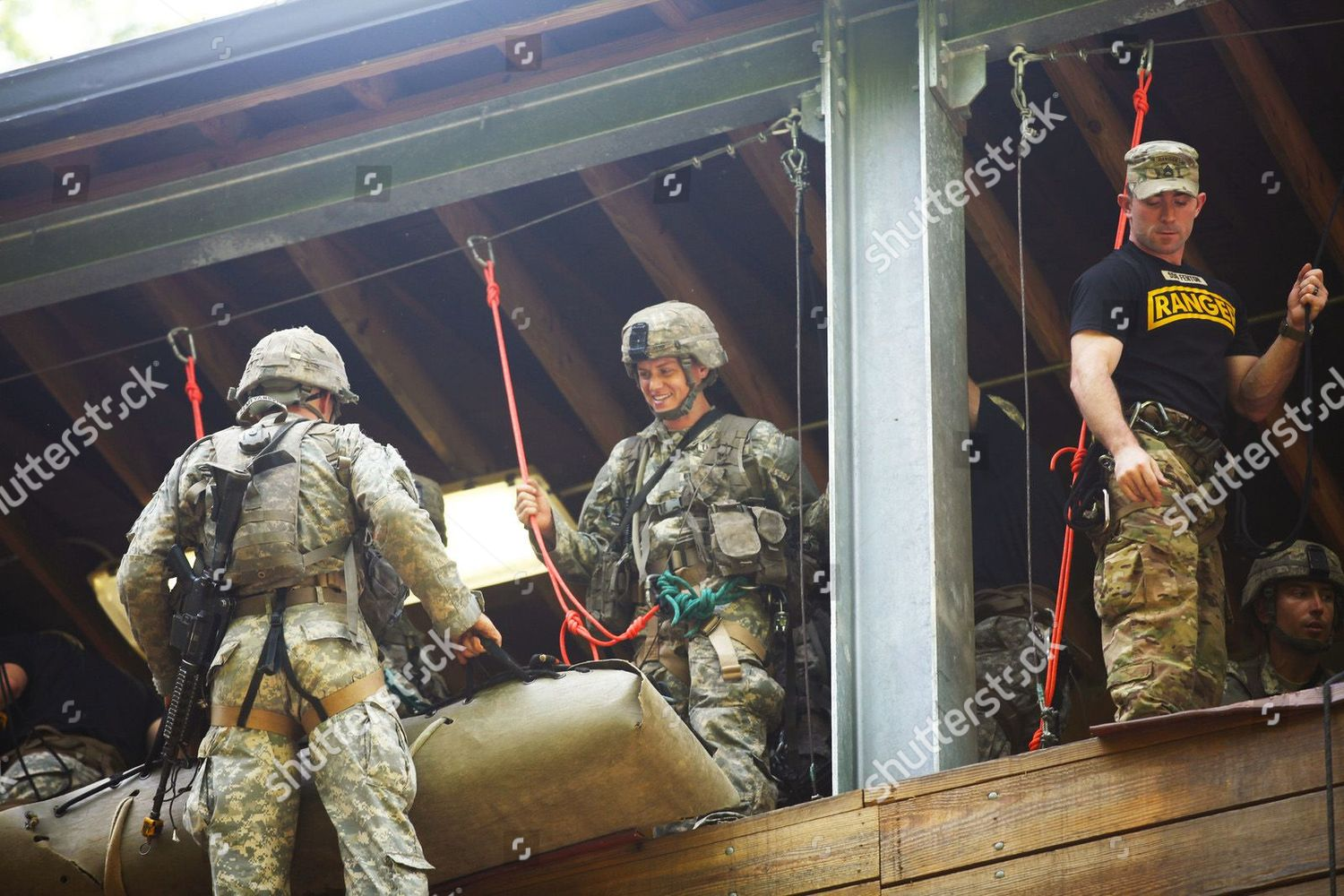 Female US Army Soldiers participate rappel training