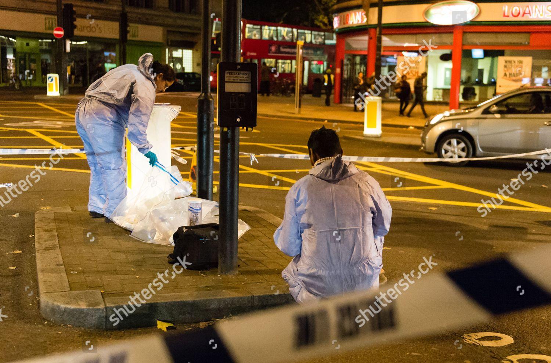 Forensic police attend crime scene where violent Editorial Stock