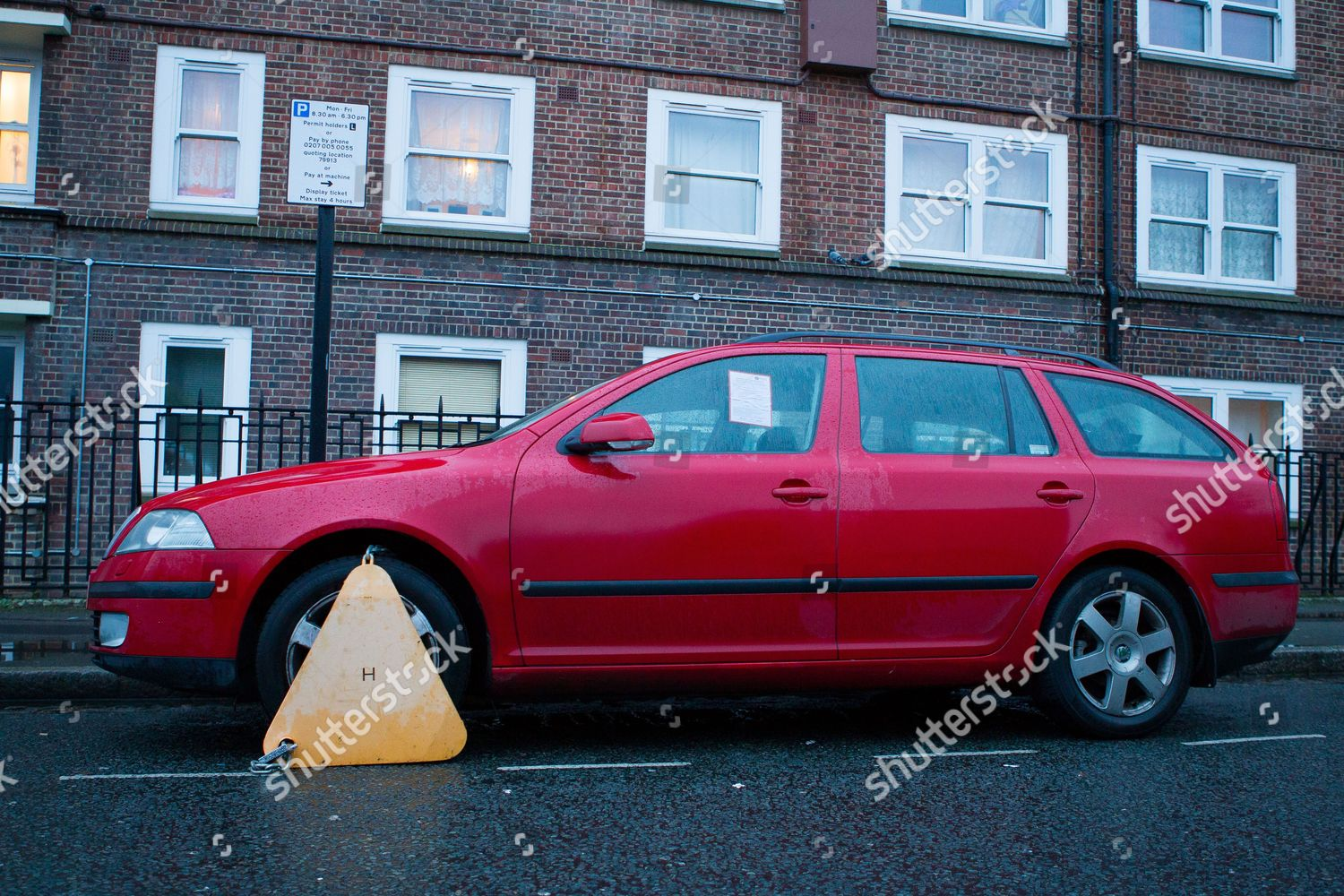 red car wheel clamp on street London Editorial Stock Photo - Stock