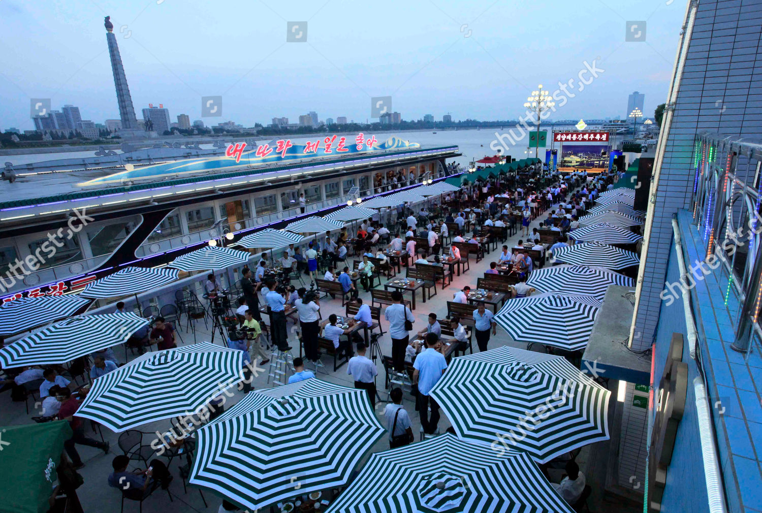 North Koreans gather along Taedong River where Editorial Stock Photo