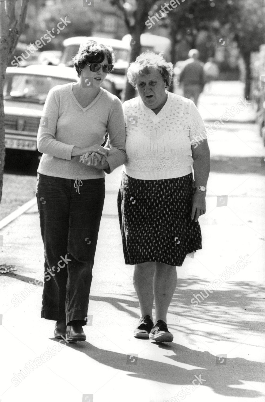 Blind Widow Joan Fielding right Walking Her Editorial Stock