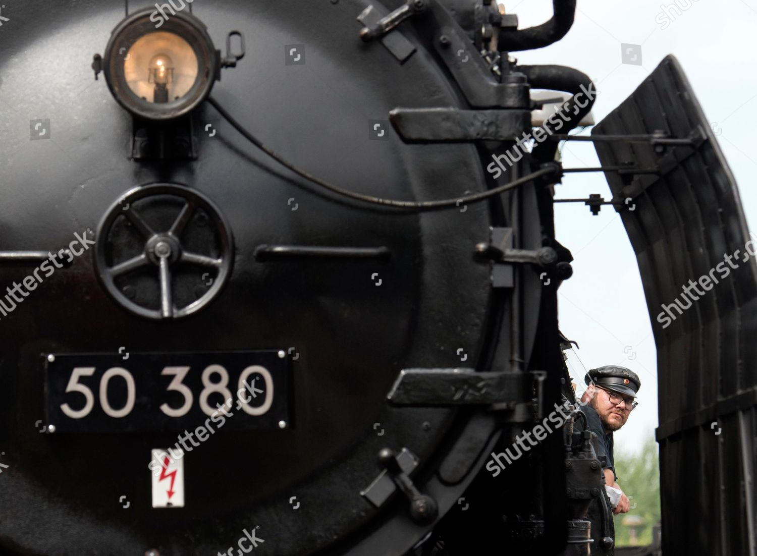 locomotive driver looks out his drivers cab Editorial Stock