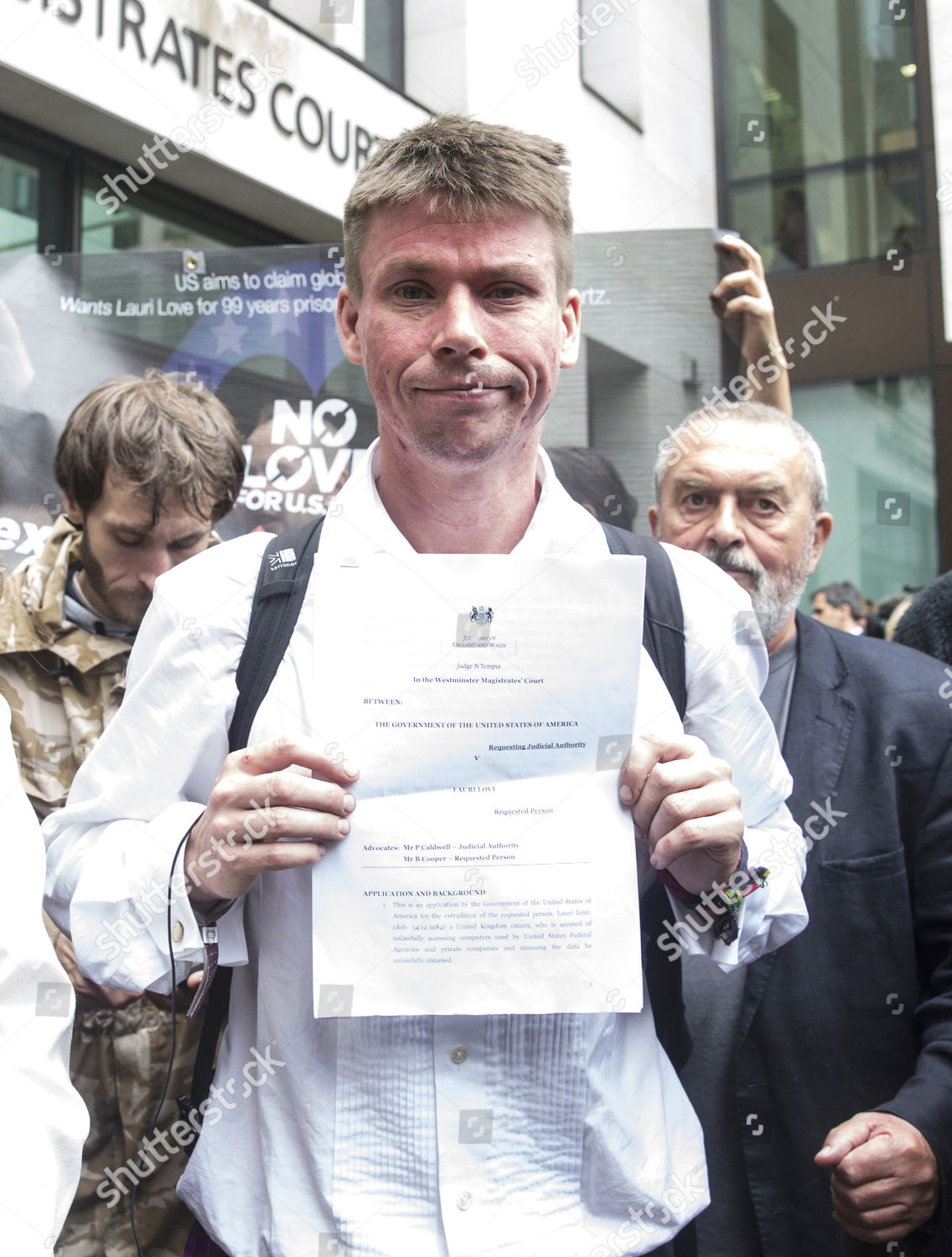 Lauri Love shows court papers which read Editorial Stock
