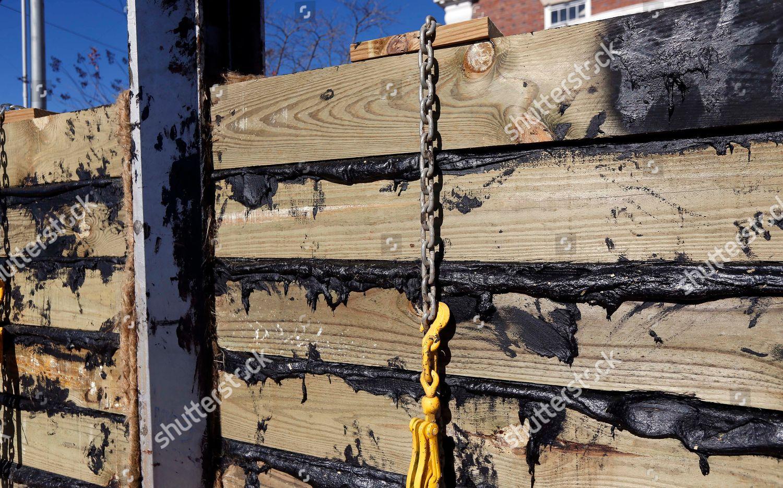 Railroad ties tar used flood gates adjacent Editorial Stock Photo