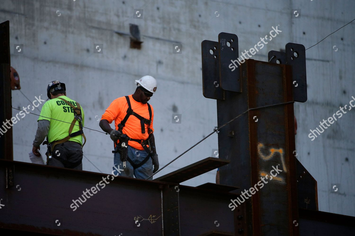 Iron workers work on new Comcast Innovation Editorial Stock
