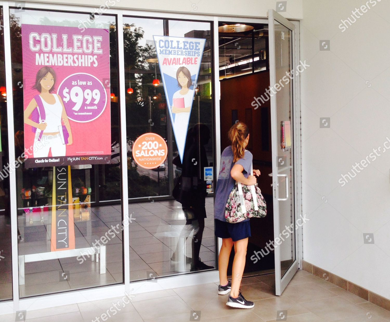 Customer Enters Sun Tan City Tanning Salon Editorial Stock Photo