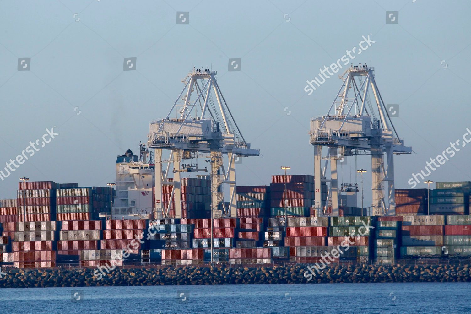 Cargo containers seen on top ships anchored Editorial Stock Photo