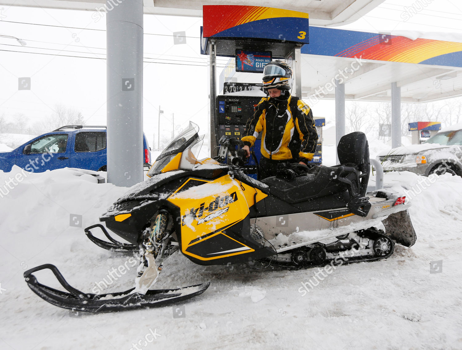 Jason Burris Jason Burris fuels his snowmobile Editorial Stock Photo
