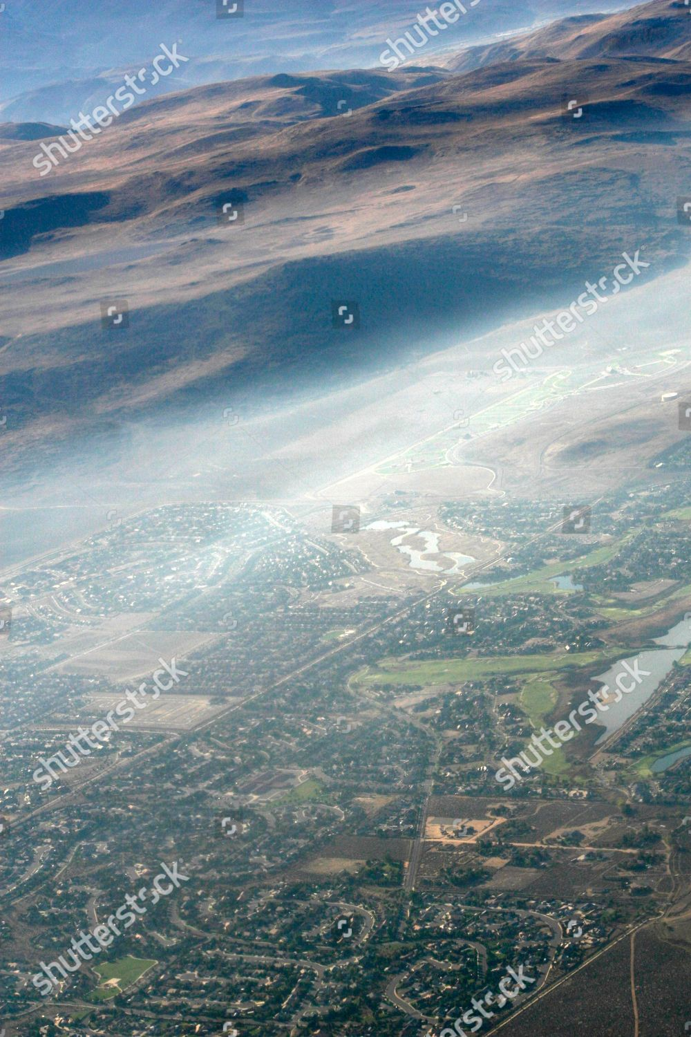 this aerial photo smoke hovers above city Editorial Stock