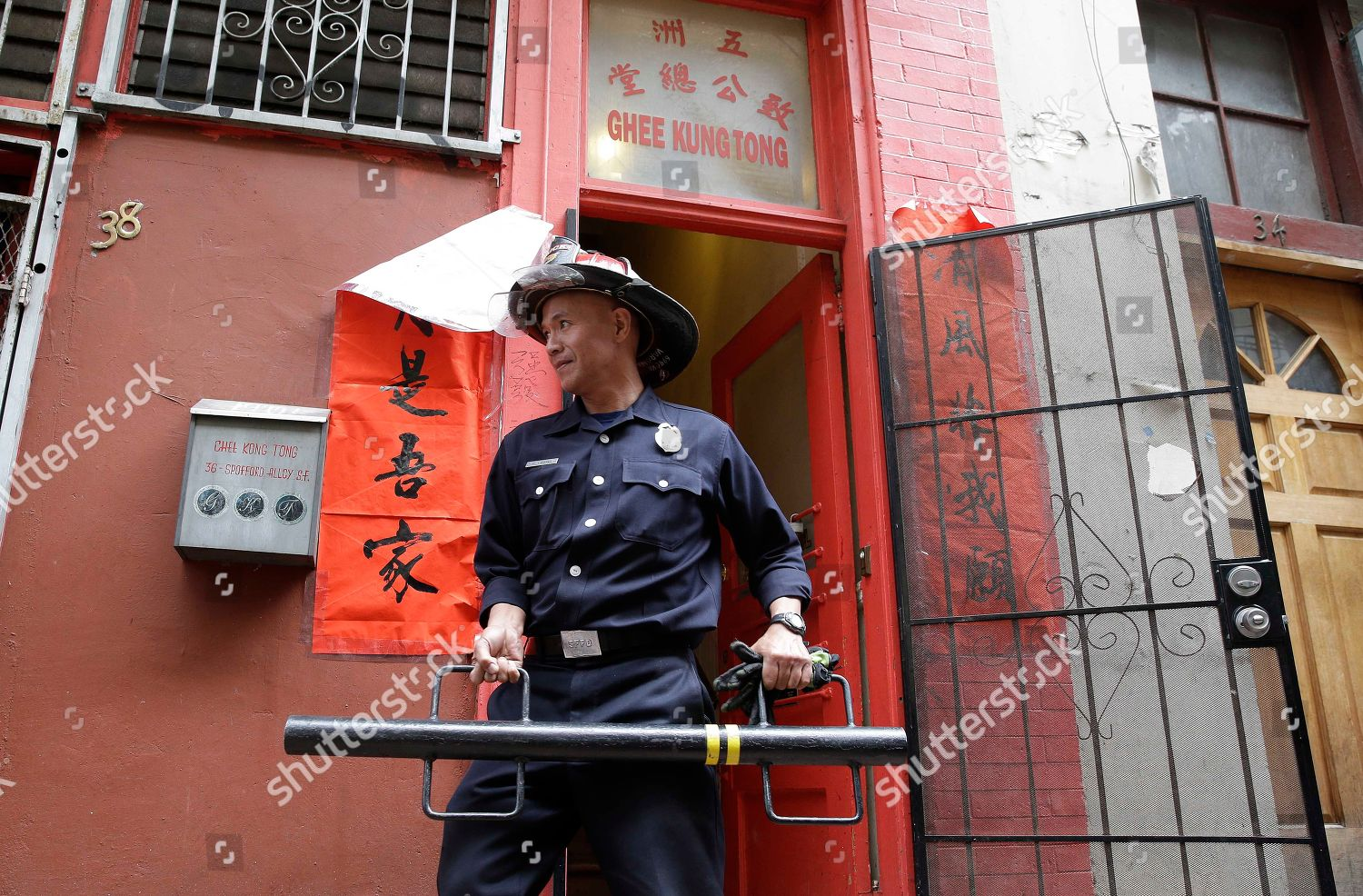 San Francisco fireman carries away one many Editorial Stock