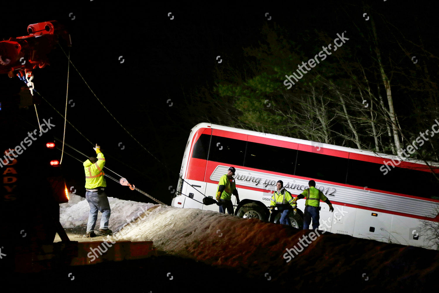 tow crew work pull crashed bus embankment Editorial Stock
