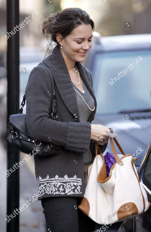 605cb1eab5b6d Kate Middleton looking happy she strolls through Editorial Stock ...