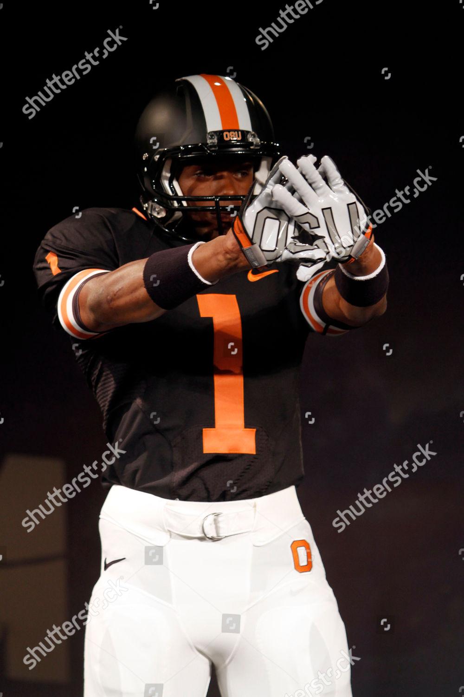 new style a76b3 f959e model wears Oregon State University Nike football Editorial ...