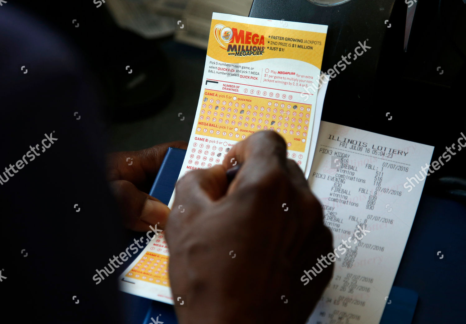 customer picks numbers his Mega Millions lottery Editorial
