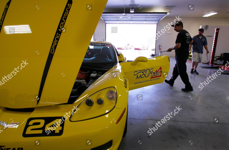 Mechanics work on Corvette garage Spring Mountain Editorial
