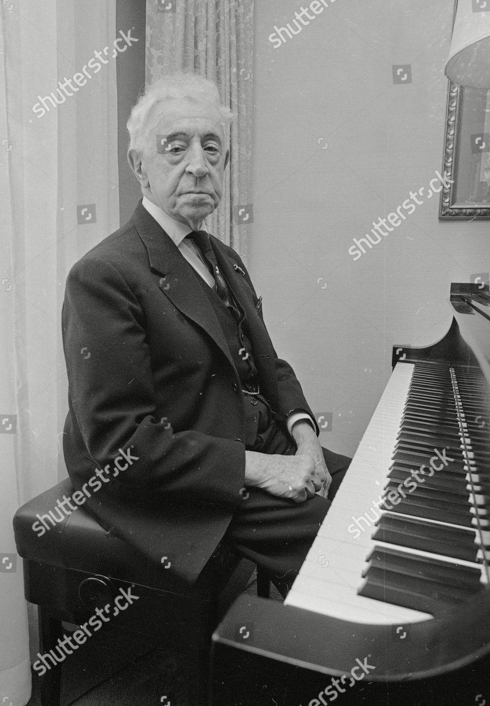 Rubinstein Pianist Arthur Rubinstein sits by piano Editorial