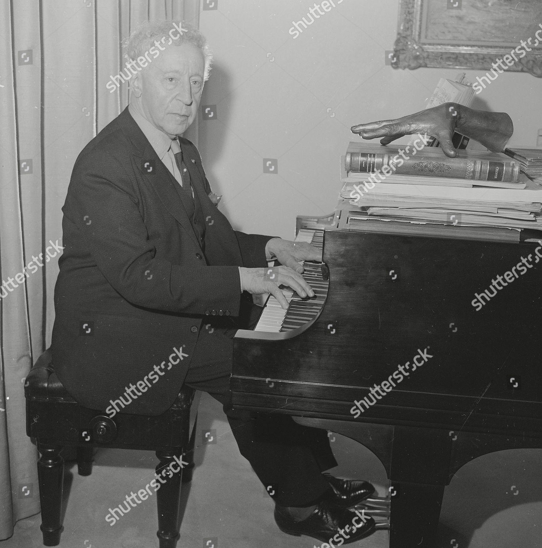 Rubinstein Pianist Arthur Rubinstein sits piano his